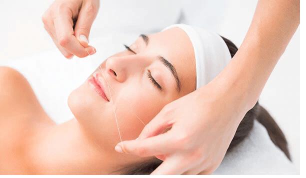 female threading facial hair removal